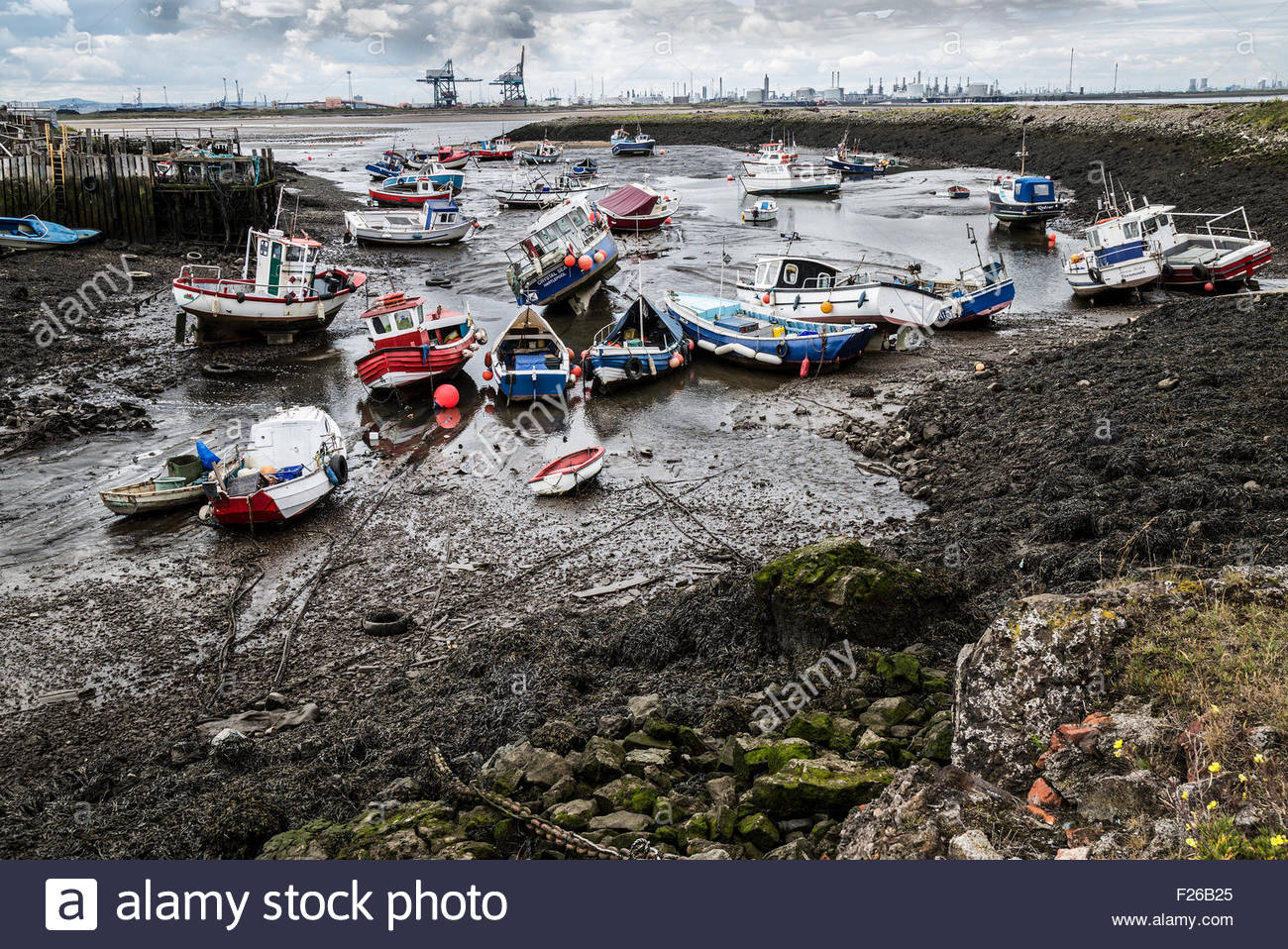 Boats at low tide in Paddy's Hole - Stock Image