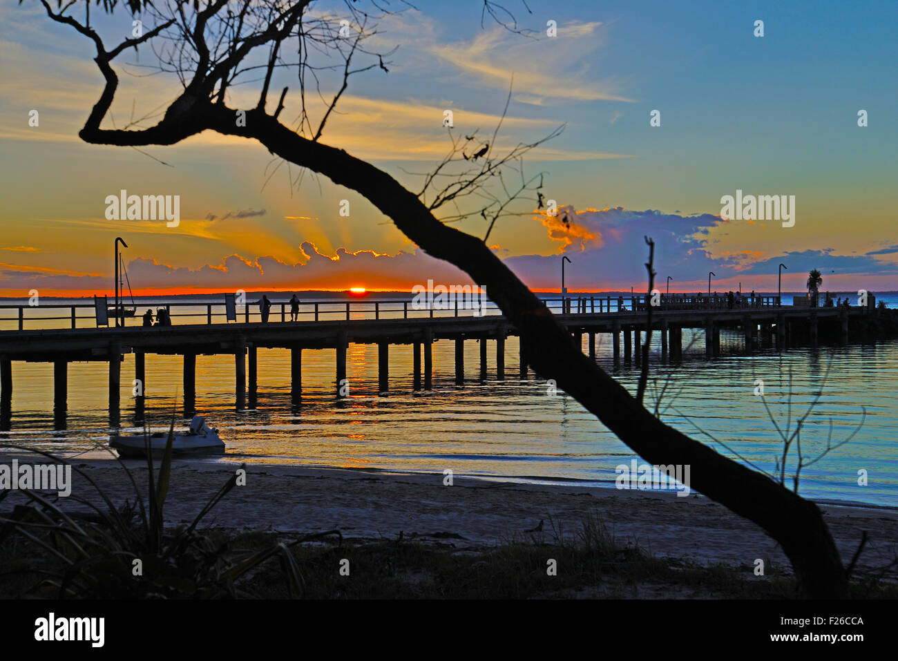 Unique colorful sunset over jetty image captured from Fraser Island, Queensland, Australia - Stock Image