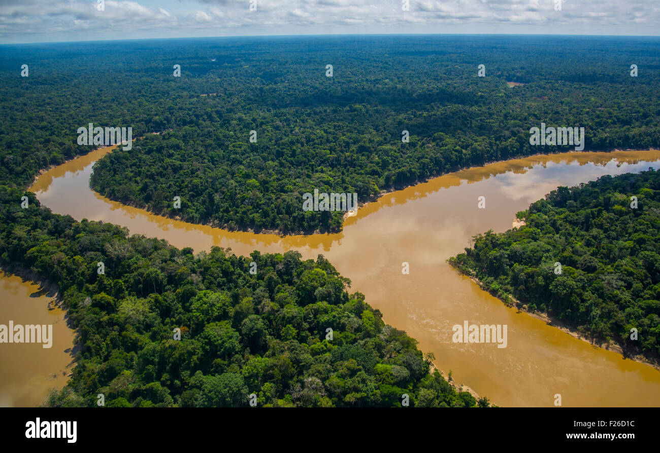 Rainforest aerial, Mouth of the Yavari-Mirin River entering Yavari River and primary forest, Amazon Region, Peru - Stock Image