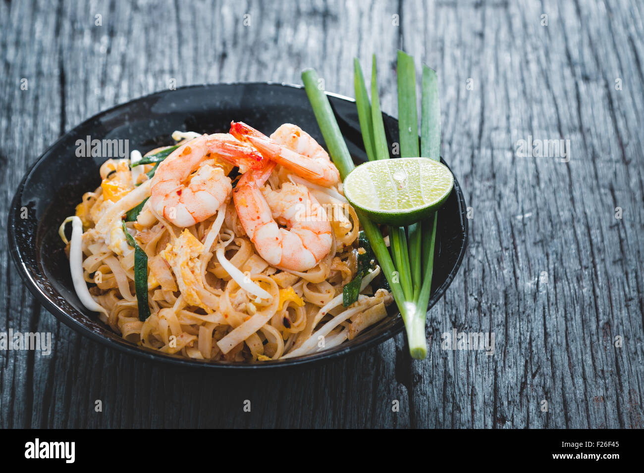 "Thai Fried Noodles ""Pad Thai"" with shrimp and vegetables Stock Photo"