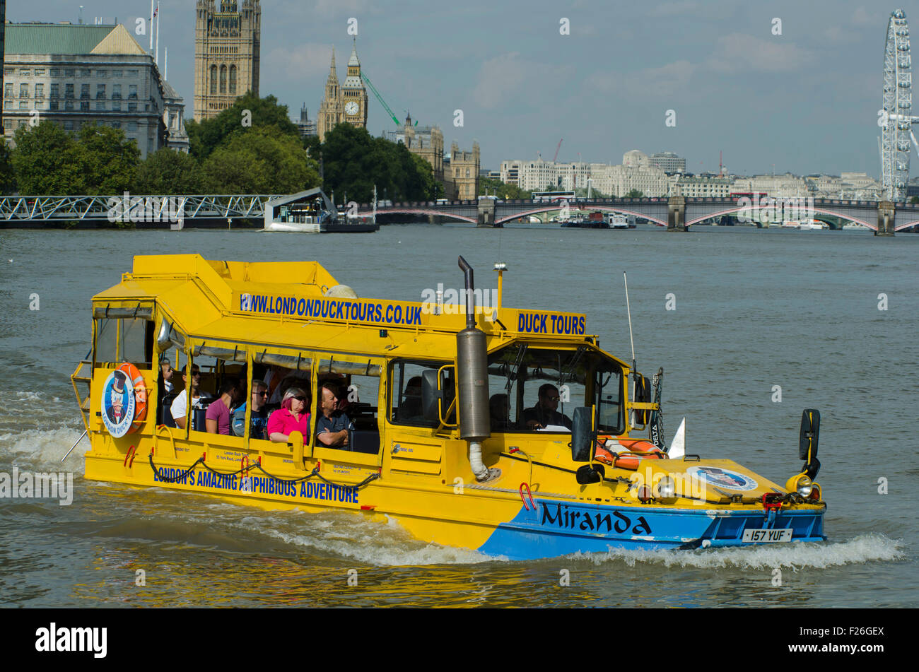 London,UK,11/09/2015 London Duck Tours at work carrying tourists on sunny day on Thames.DUKW,or Duck,is six-wheel - Stock Image