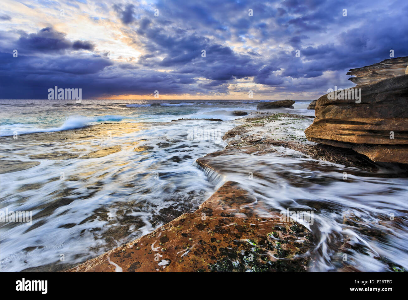 Picturesque pacific coastline at sunrise near Maroubra beach in Sydney - Stock Image