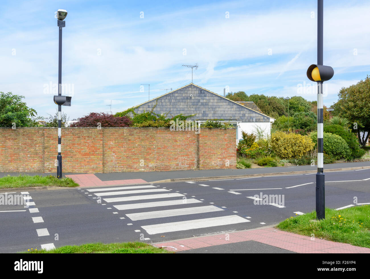 Zebra crossing across a road in West Sussex, England, UK. Stock Photo