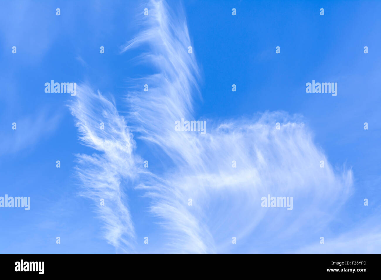 Cirrus clouds in blue sky on a bright sunny day. - Stock Image