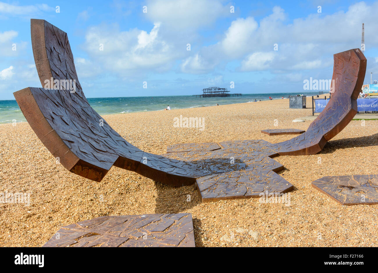 Passacaglia abstract sculpture made of recycled cast iron by Charles Hadcock on Brighton Beach, East Sussex, England, - Stock Image