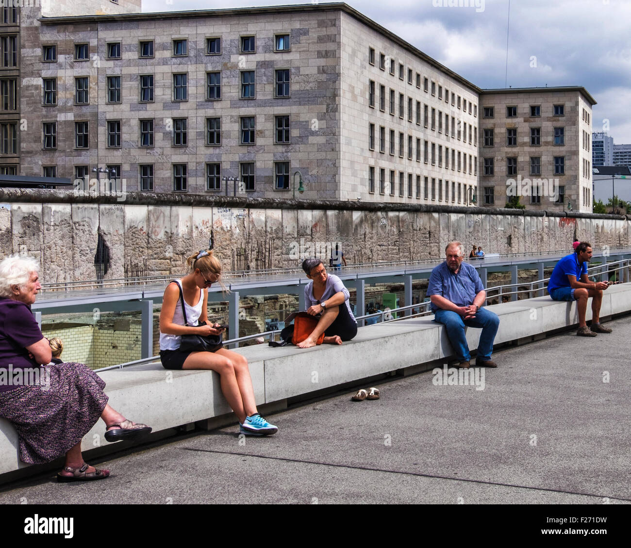 Berlin. Tourists visit Topography of Terror indoor and outdoor museum & memorial - Excavated Gestapo building - Stock Image