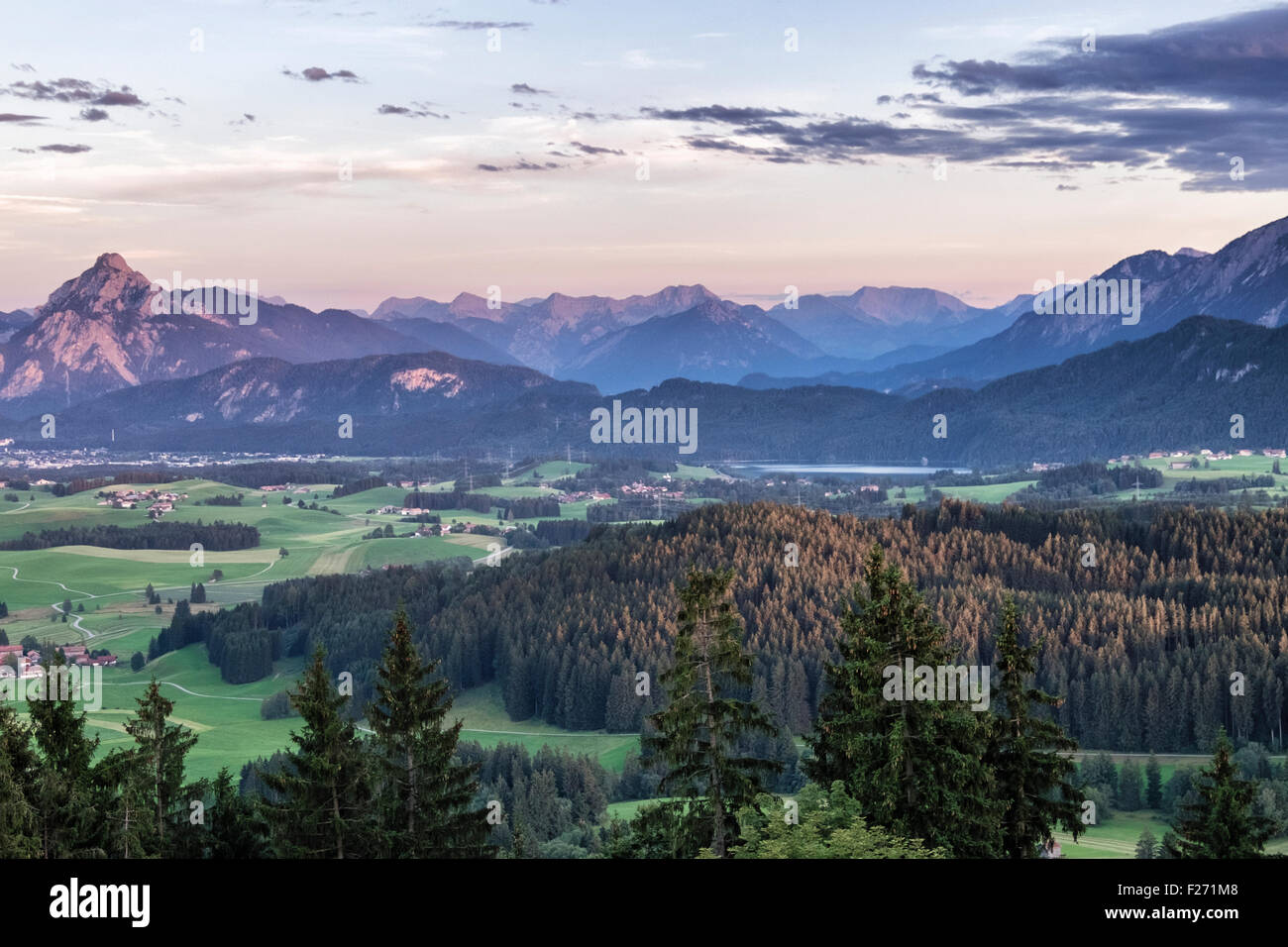 Scenic landscape View across valley, forest and farm lands towards Bavarian Alps, Eisenburg, Bavaria, Germany - Stock Image