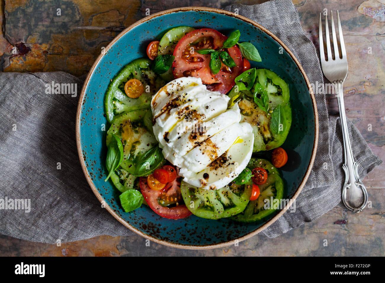 Tomatoes, mozzarella and basil salad - Stock Image