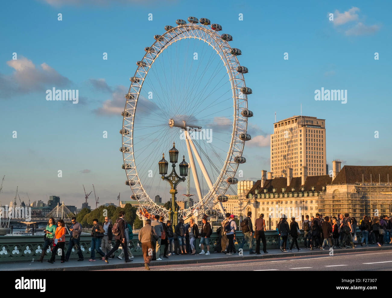 London Eye viewed from popular tourist spot near Westminster Bridge, London, England UK - Stock Image