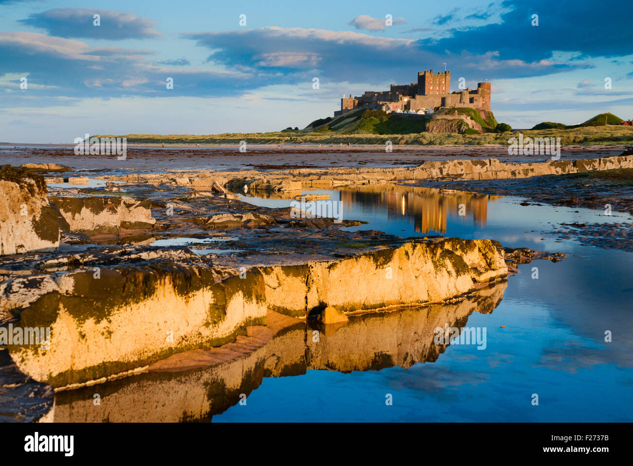 Bamburgh Castle on the north east coast of Northumberland. Once the residence of the Kings of Northumbria. - Stock Image