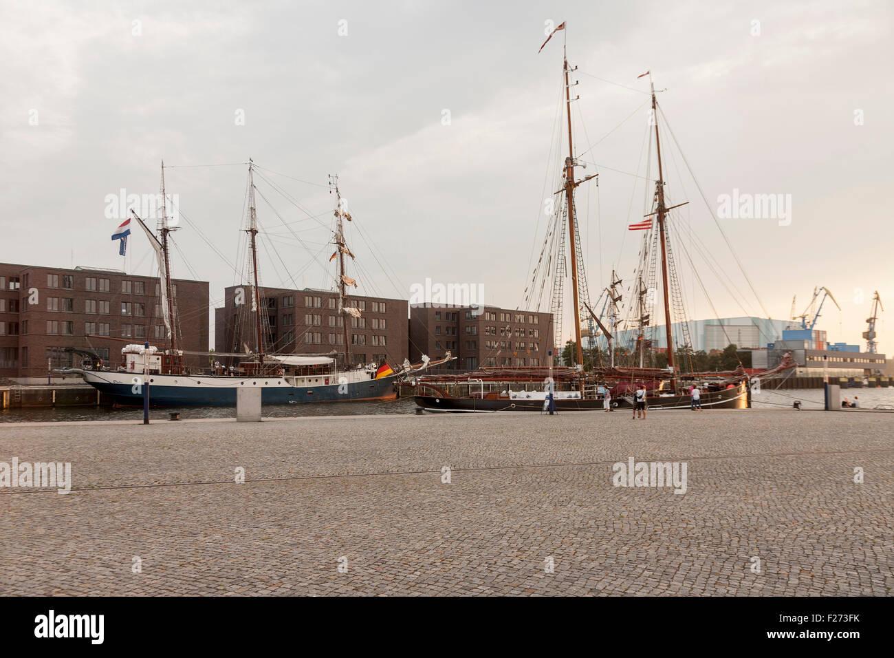 Sailboats moored at a harbour, Wismar, Mecklenburg-Vorpommern, Germany - Stock Image