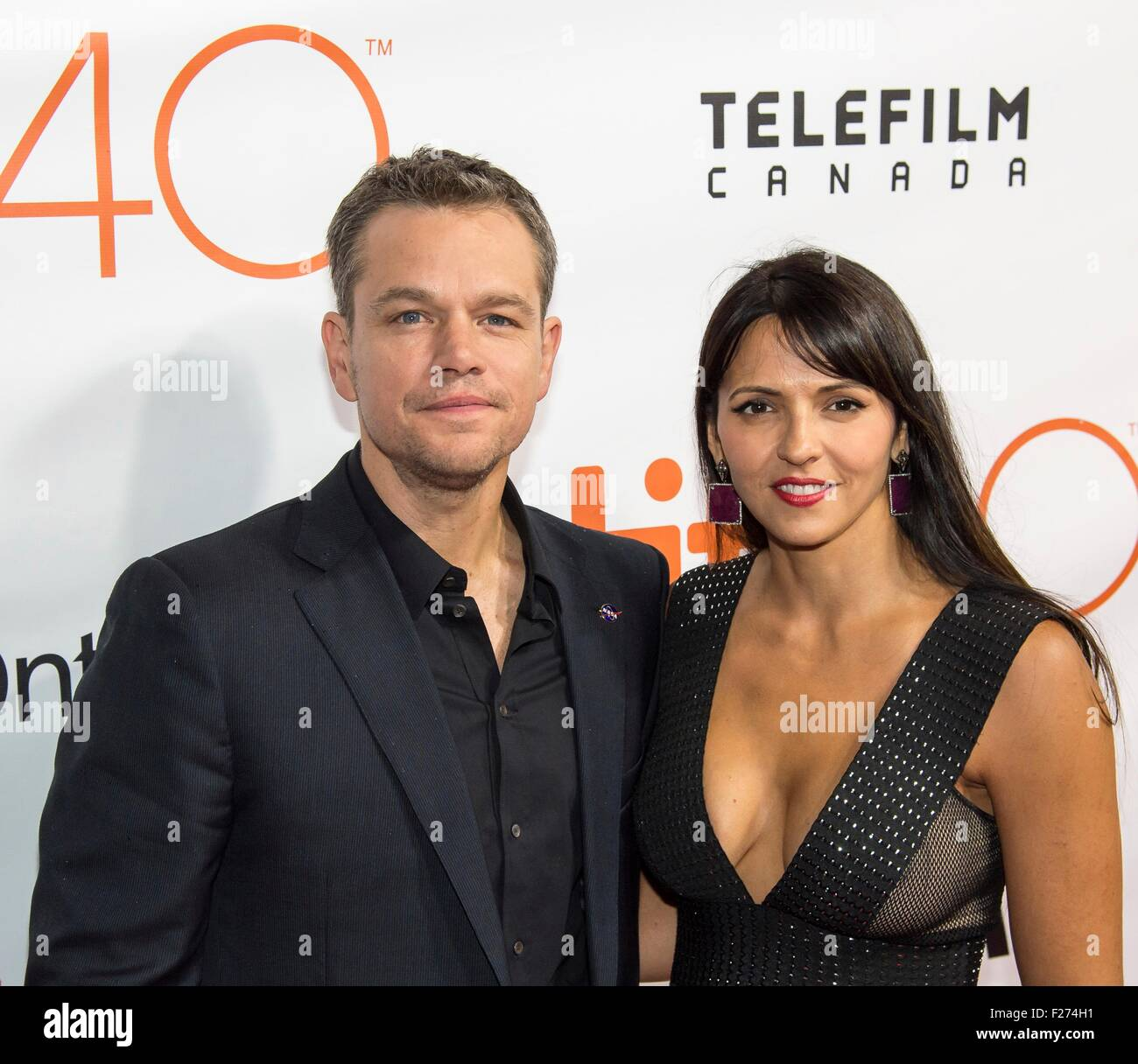 Actor Matt Damon and his wife Luciana Bozan Barroso attend the world premiere for The Martian at the Toronto International - Stock Image