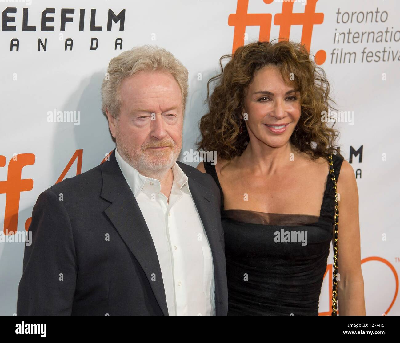 Director Ridley Scott and his wife Gianina Facio attend the world premiere for The Martian at the Toronto International - Stock Image