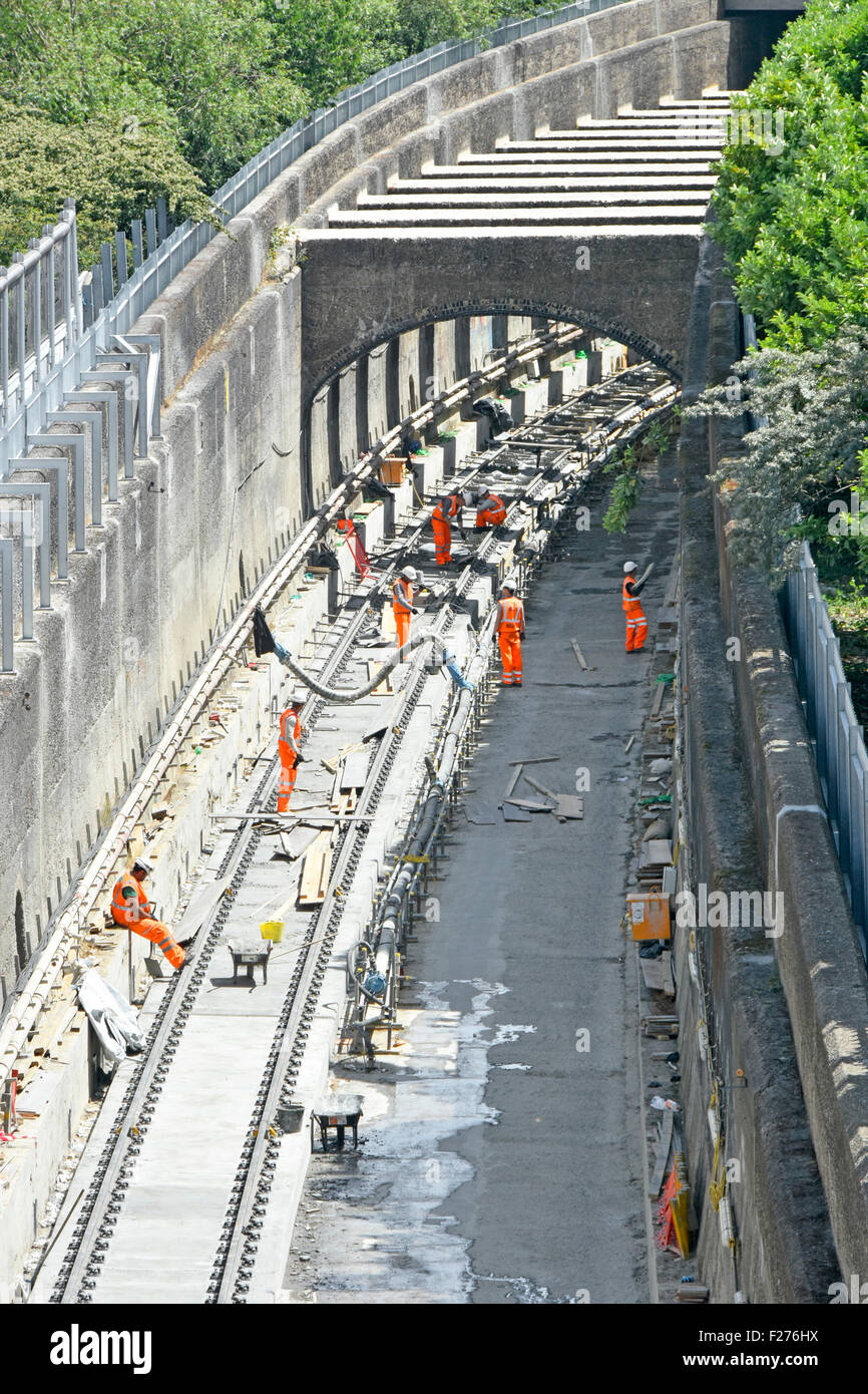 Crossrail new train tracks being laid in deep cutting emerging from tunnel on the Canary Wharf to  Abbey Wood branch - Stock Image