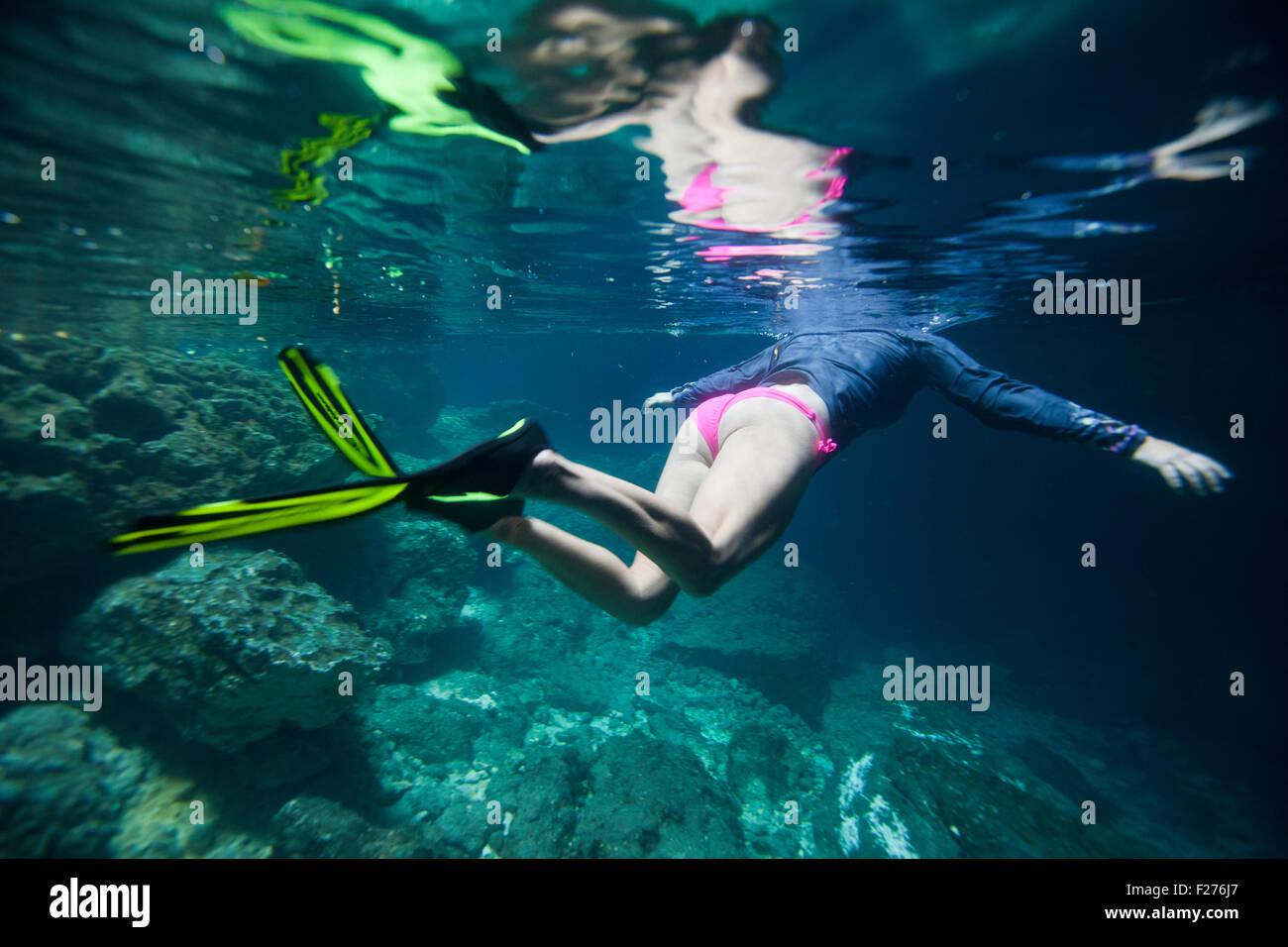 bikini clad Woman Snorkeling in Devils Den Underground Spring in Williston Florida - Stock Image
