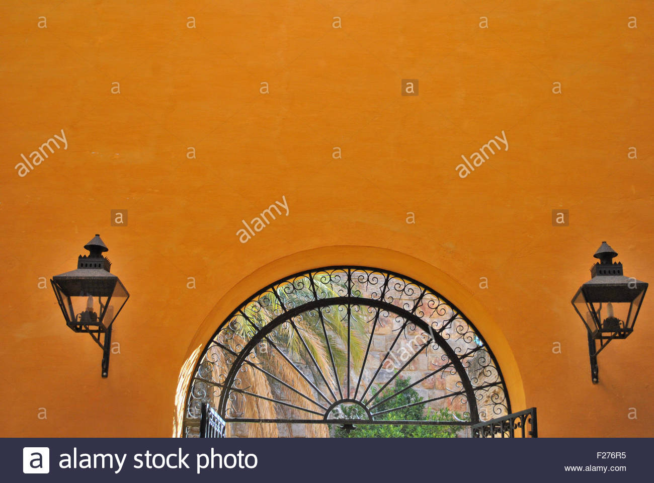 Mediterranean lighters on orange wall - Stock Image
