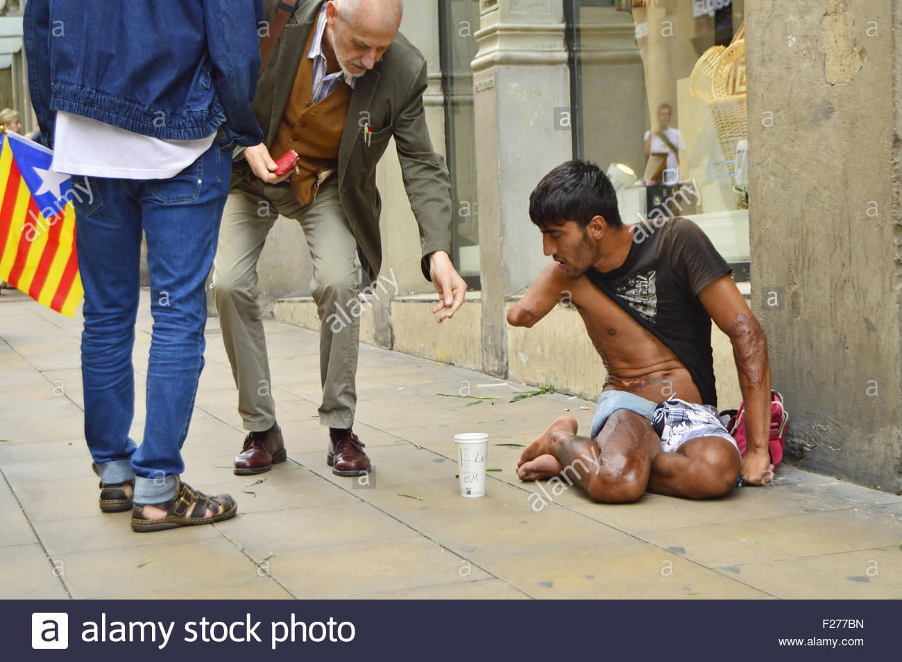 Disabled armless man begging for money in the streets of Barri Gotic (Old Town)  Barcelona Spain Europe. National - Stock Image