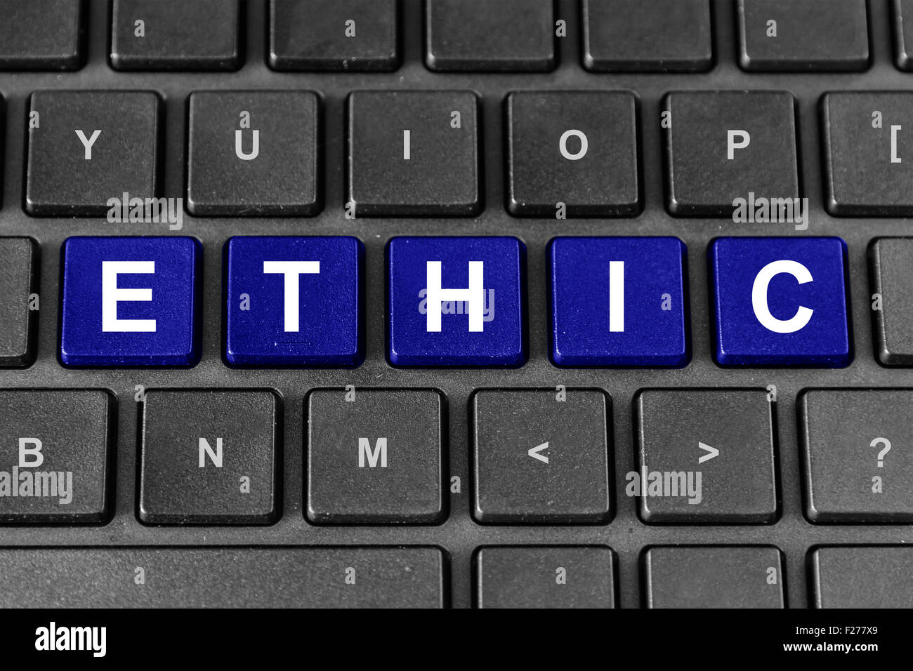 ethic blue word on keyboard, business concept - Stock Image
