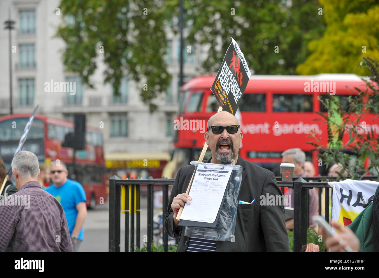 A demonstration in support of refugees and migrants in London. - Stock Image