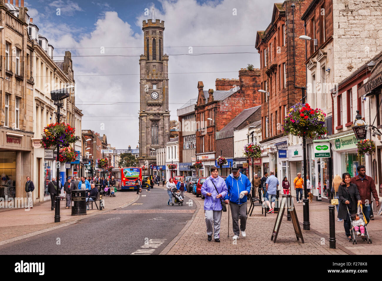 A busy shopping day in High Street, Ayr, South Ayrshire, Scotland. The clock tower is the Wallace Tower. - Stock Image