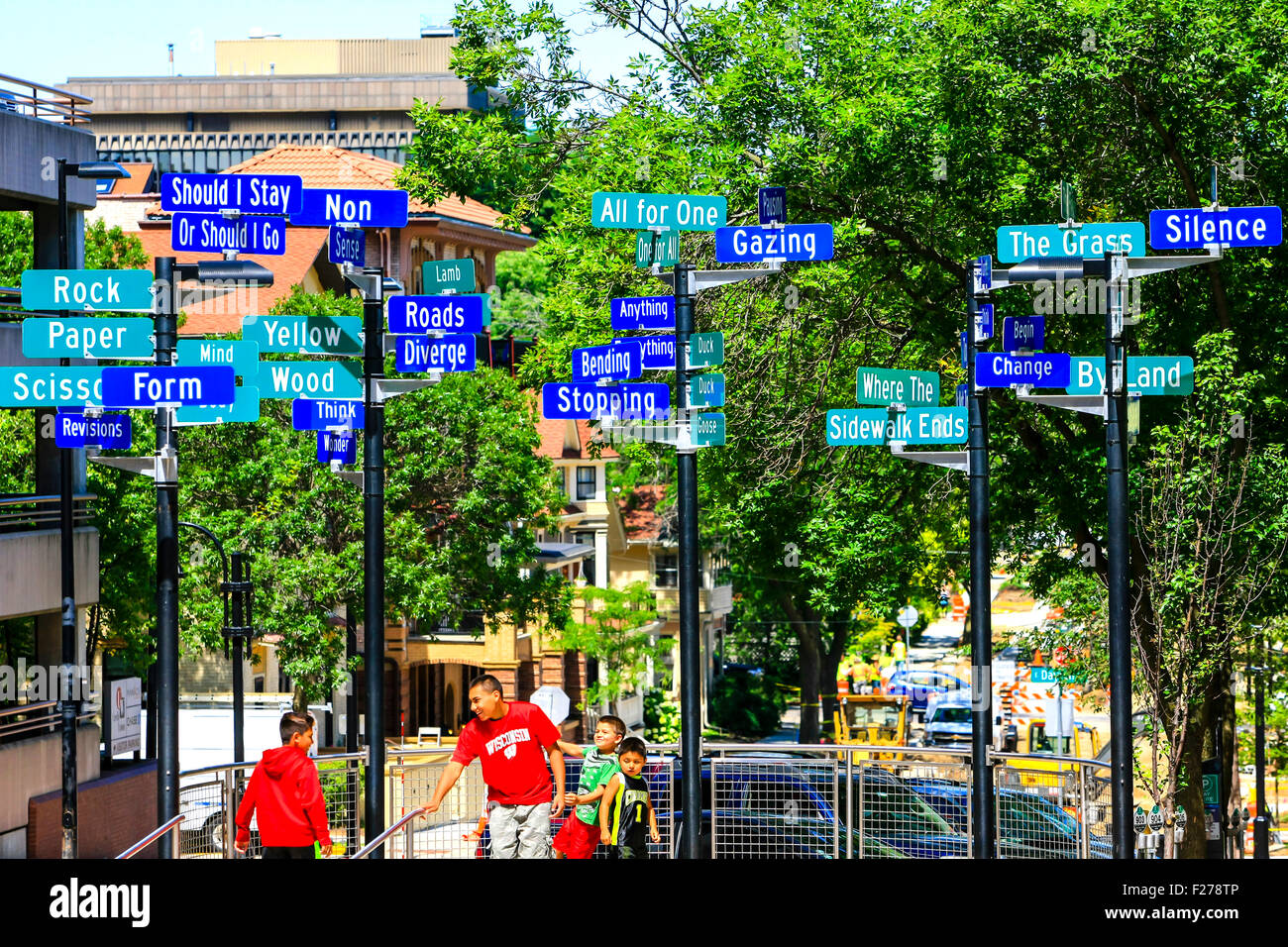 Signposts of words on Carroll Street in downtown Madison, Wisconsin - Stock Image