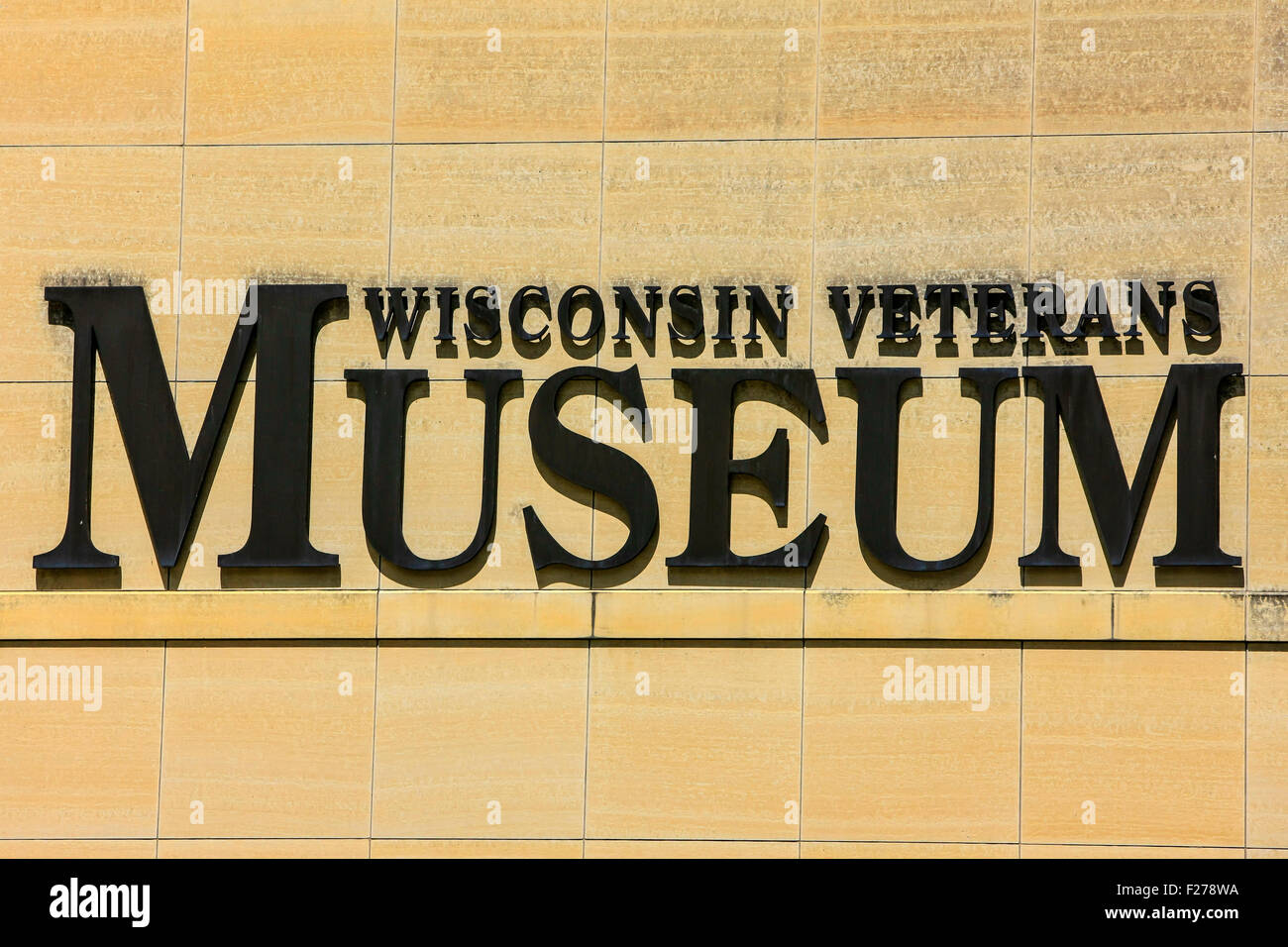 The Wisconsin Veterans Museum sign on the wall outside the building in downtown Madison - Stock Image