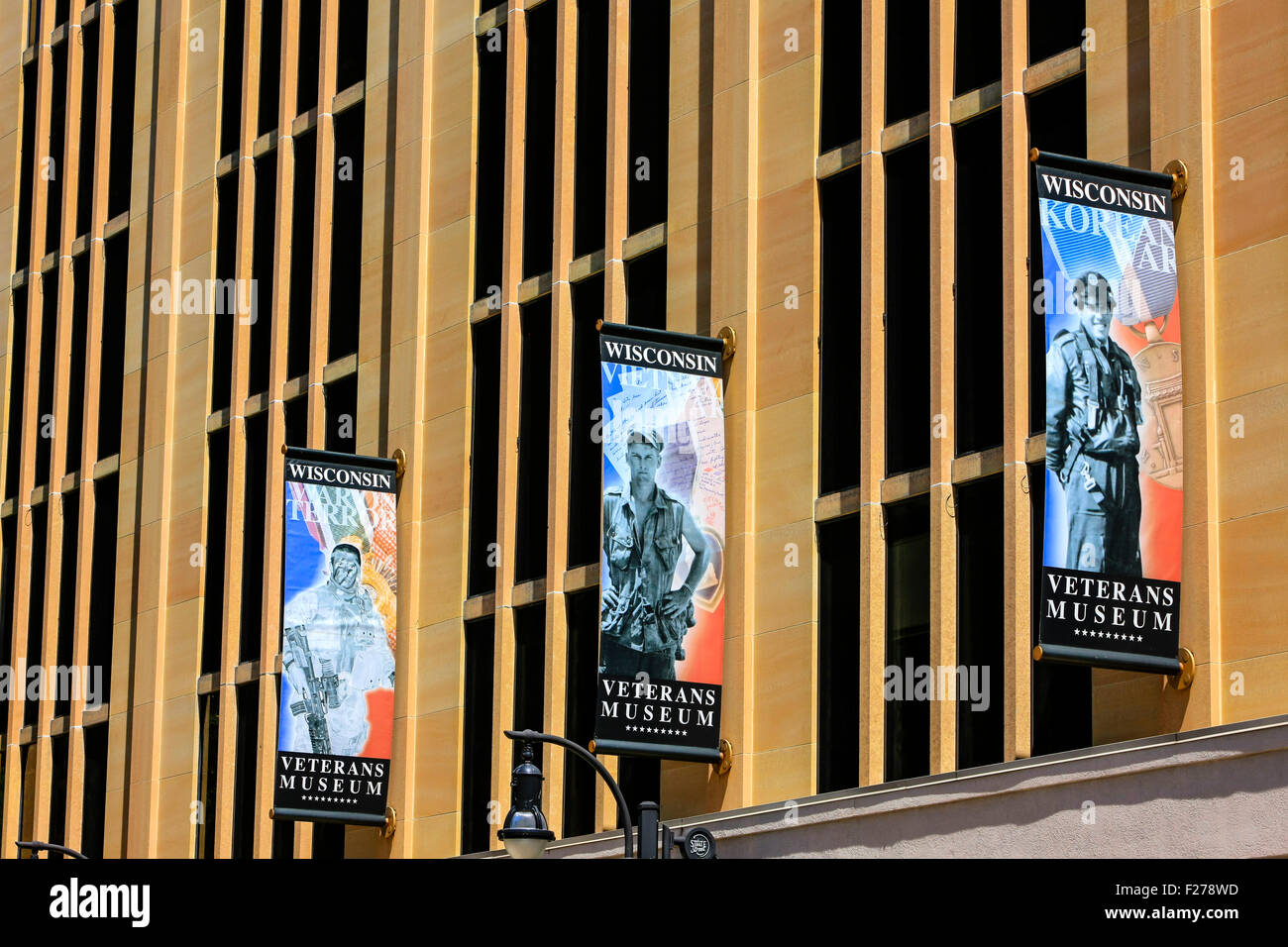 The Wisconsin Veterans Museum banners on the building in downtown Madison - Stock Image