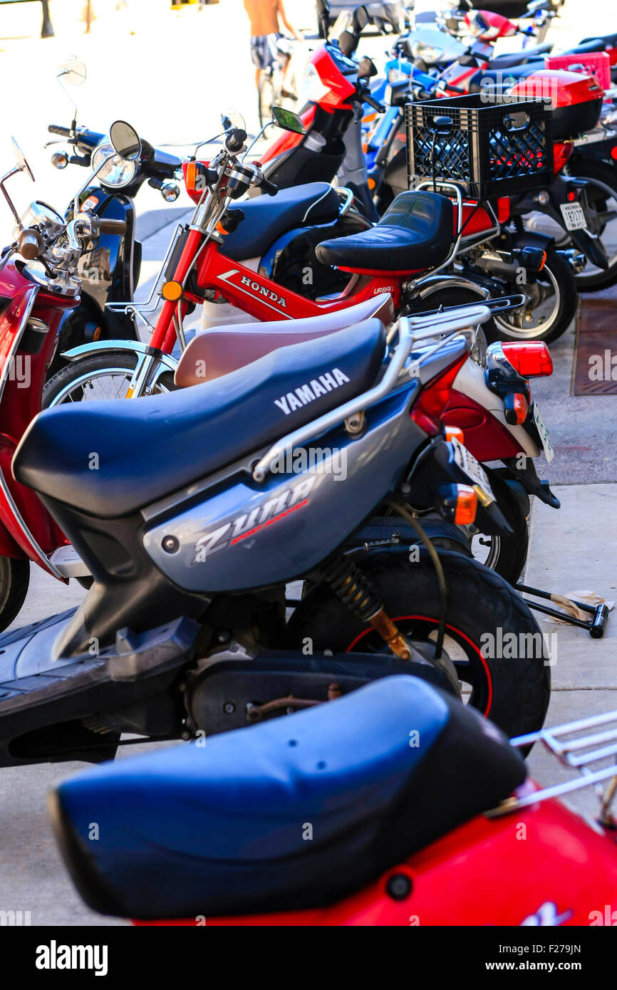 Scooters parked everywhere on the campus streets of the University of Wisconsin in Madison - Stock Image
