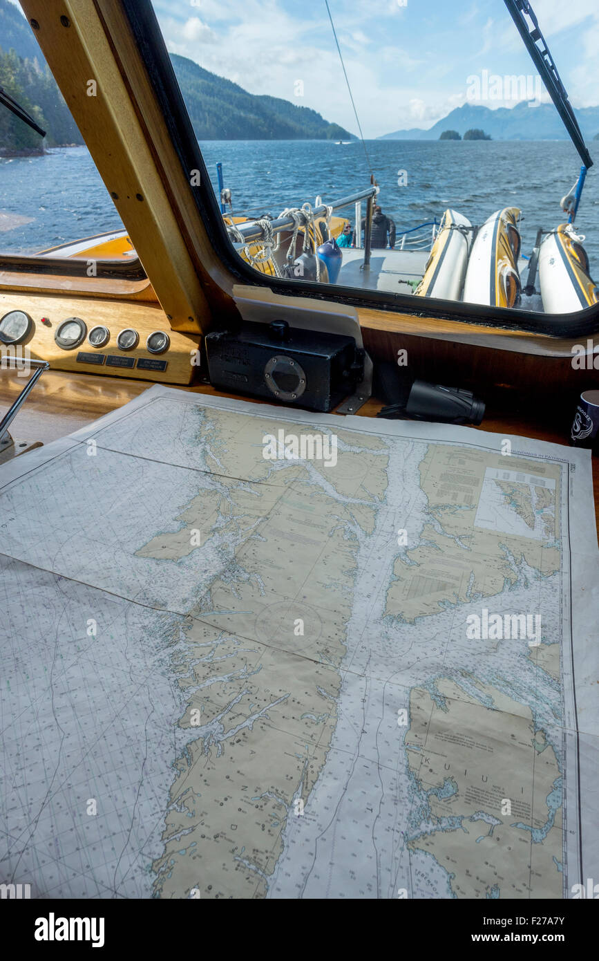 Nautical chart in the wheelhouse of a small cruise ship in Southeast Alaska. - Stock Image