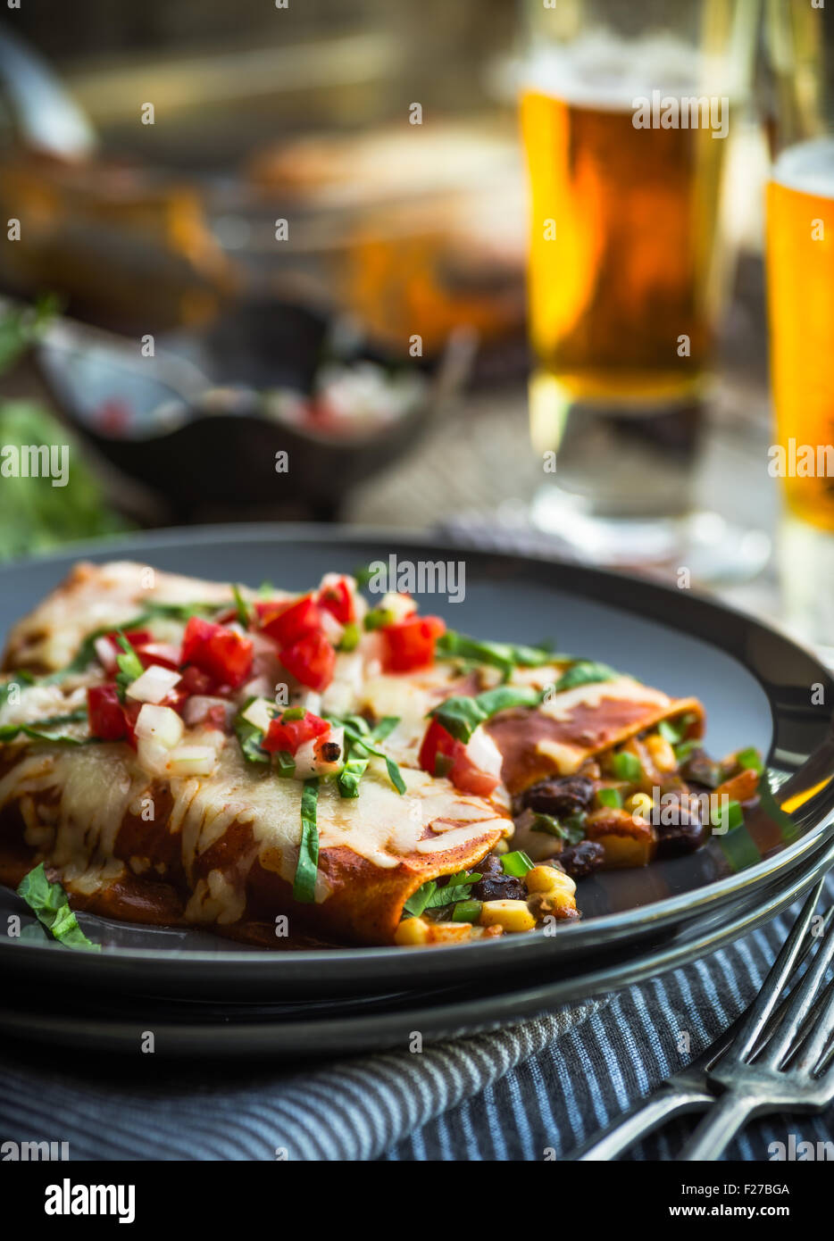 Spicy black bean and corn enchiladas with sauce and cheese Stock Photo