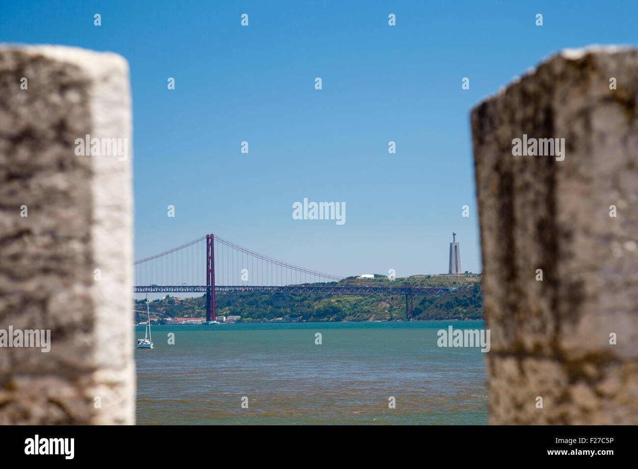 View from Torre de Belem tower up the Tagus river to the Ponte 25 de Abril bridge and Cristo Rei, Lisbon, Portugal - Stock Image