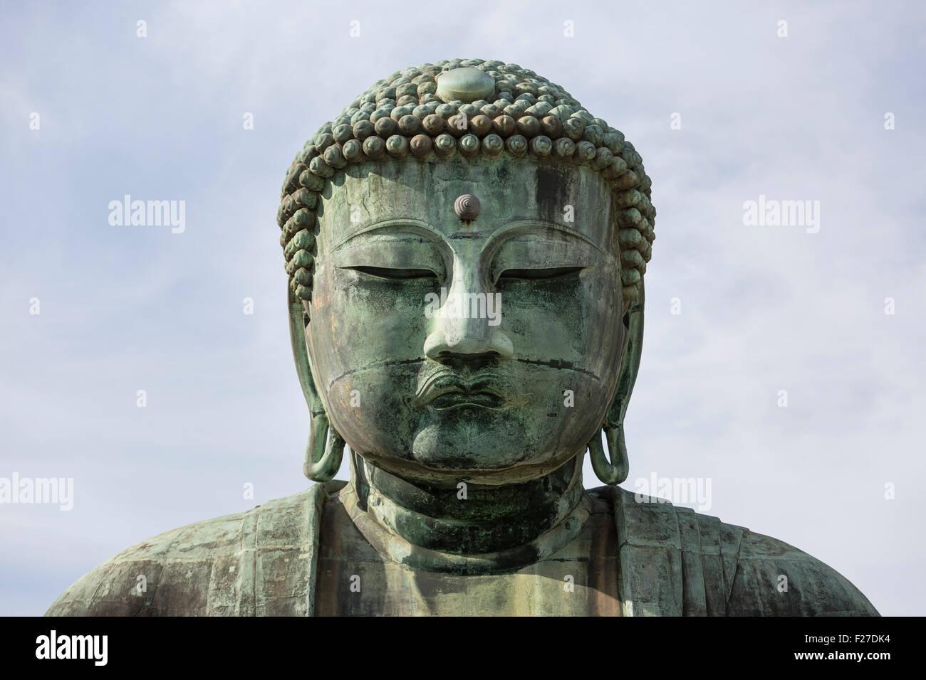 Detail of facial expression of Kamakura Daibutsu, Kanagawa Prefecture Japan. The Great Buddha of Kamakura is a monumental - Stock Image