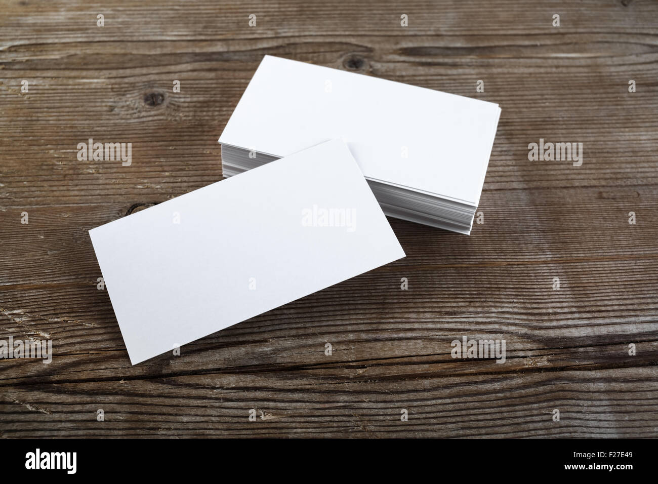 Business card blank mockup stock photos business card blank mockup photo of blank business cards on a wooden background template for id stock reheart Image collections