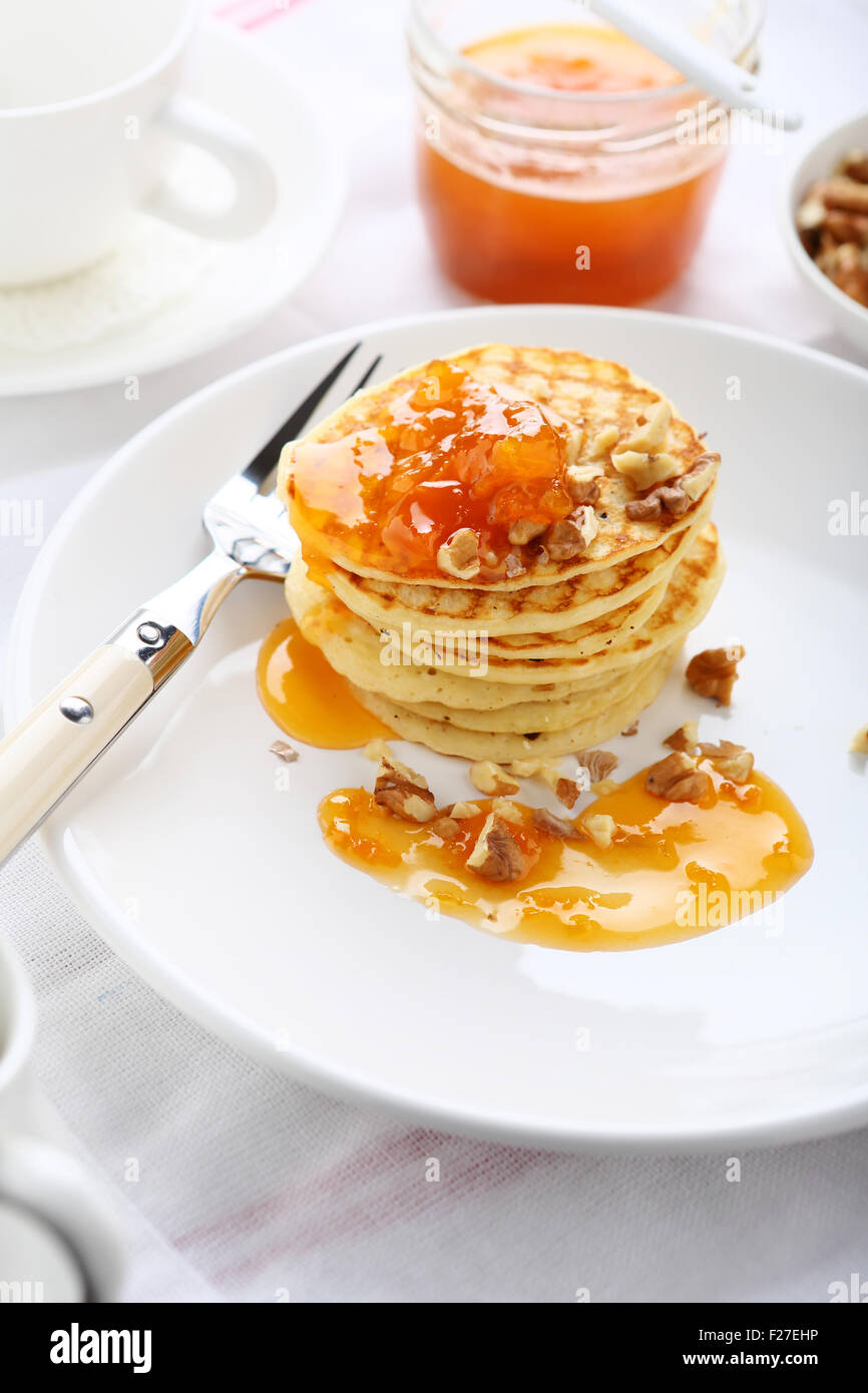 Pancakes with jam on a plate, food - Stock Image