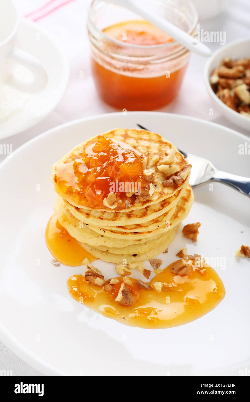 Pancakes with nuts and jam, food - Stock Image