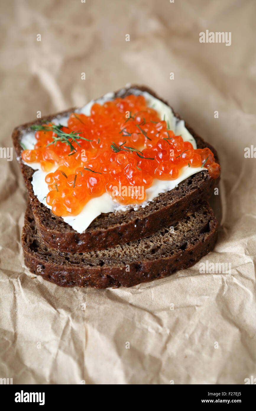 Bread and butter with caviar, food - Stock Image