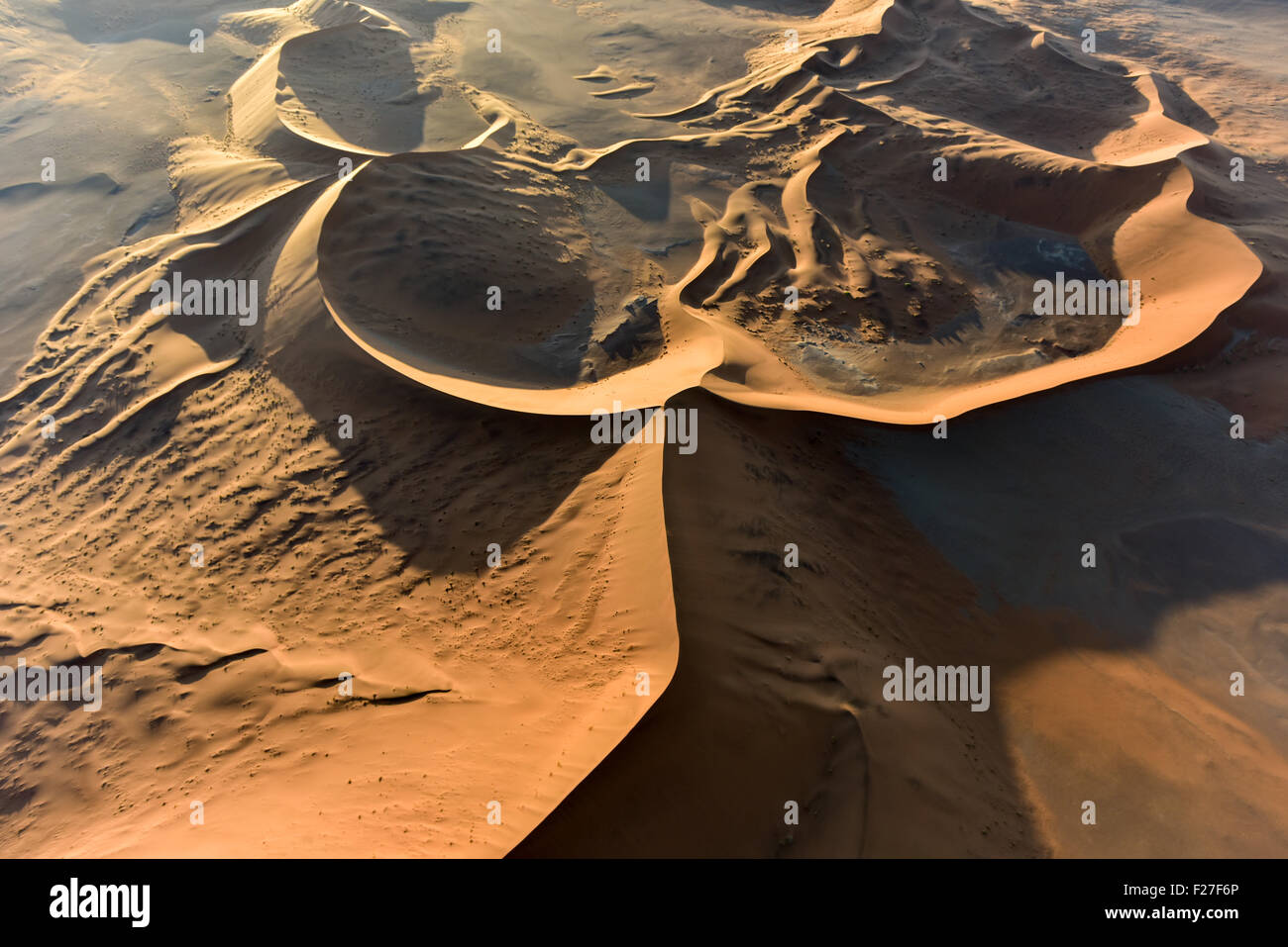Aerial view of high red dunes, located in the Namib Desert, in the Namib-Naukluft National Park of Namibia. - Stock Image