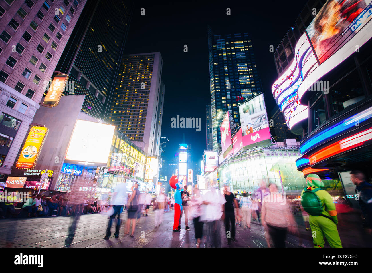 Times Square at night, in Midtown Manhattan, New York. - Stock Image