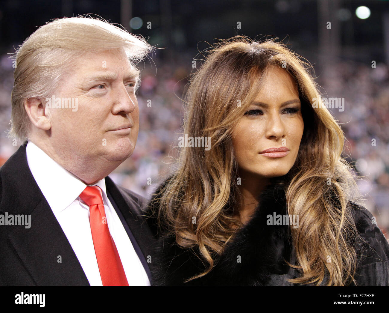 Donald Trump and wife Melania Trump at a football game at MetLife Stadium on November 13, 2011 in East Rutherford, - Stock Image