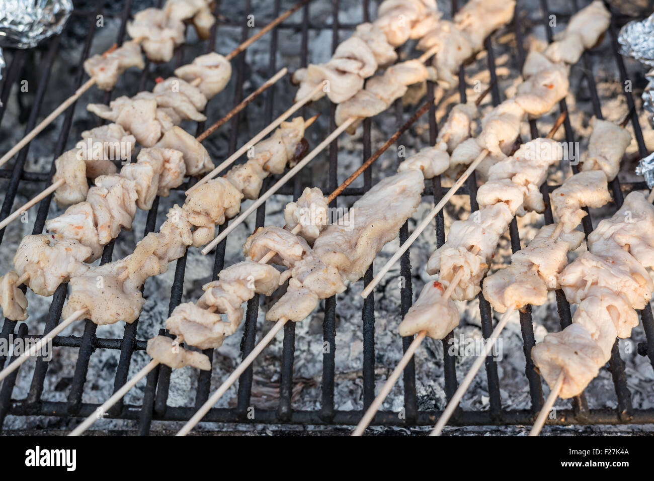 Marinated chicken skewers on a bbq grill Stock Photo