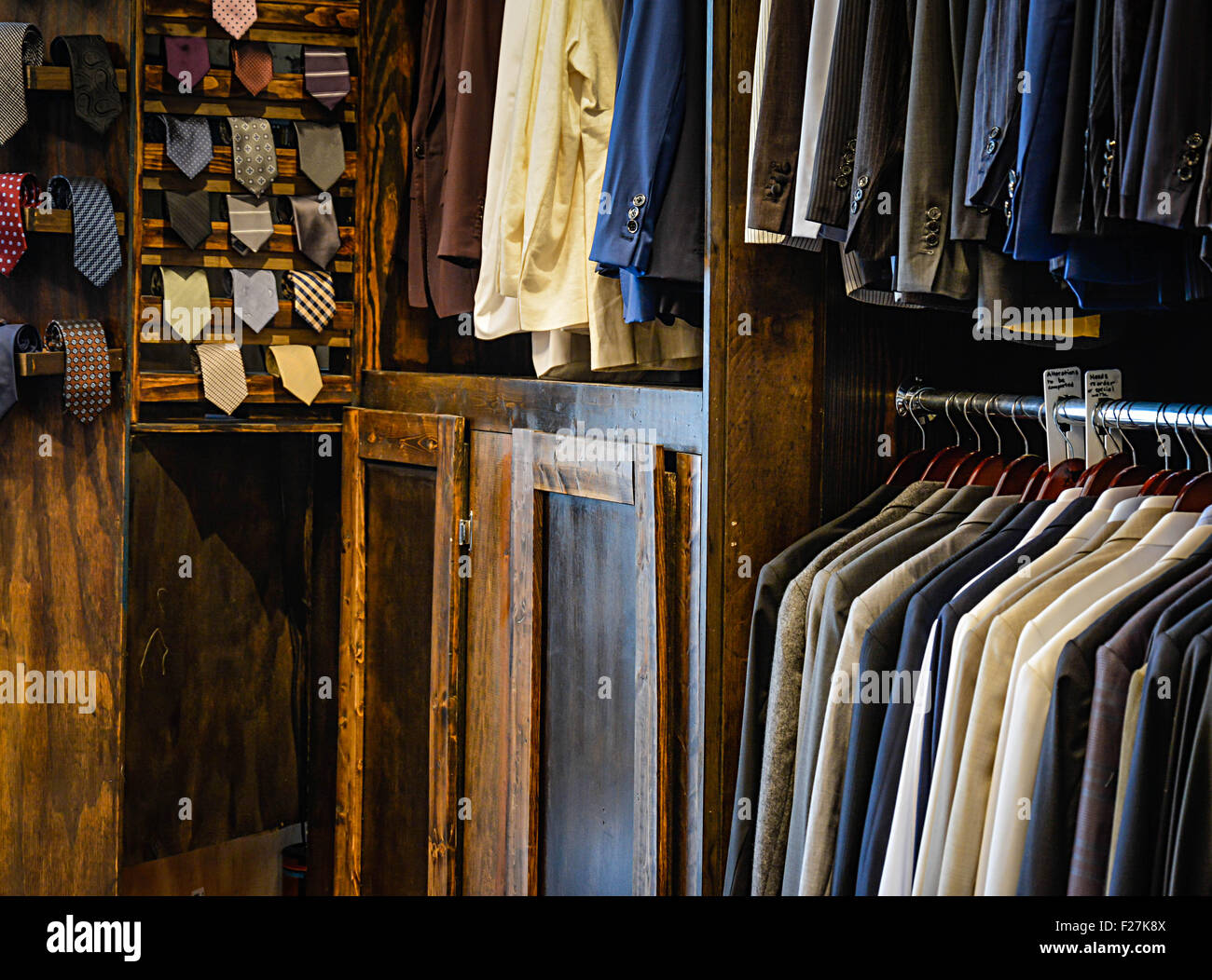Men's custom clothing store displays hanging suit coats