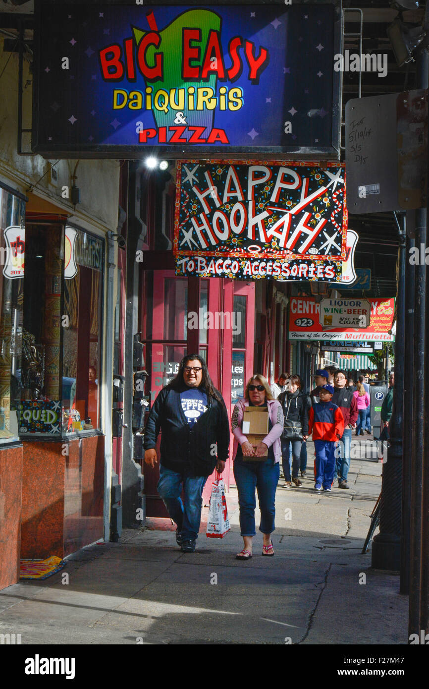 Colorful Decatur Street Shopping district includes smoke shops, Kitchenware and Muffulettas in the French Quarter, - Stock Image