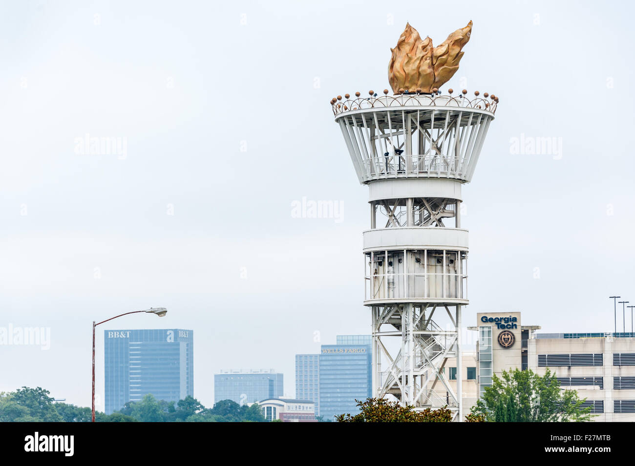 The Olympic torch tower from the 1996 Summer Olympics stands tall over Interstates 75 and 85 in the heart of Midtown - Stock Image