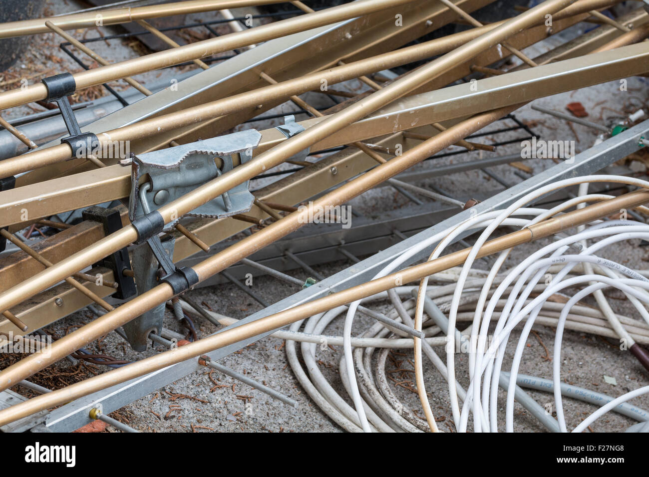 Scrap cable and metal in a waste landfill background - Stock Image