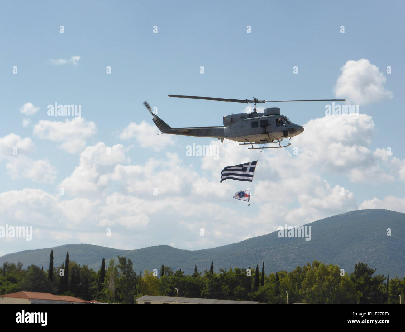 Athens, Greece. 13th Sep, 2015. A Hellenic Navy Helicopter Command AB212 ASW hellcopter flies over the spectators Stock Photo