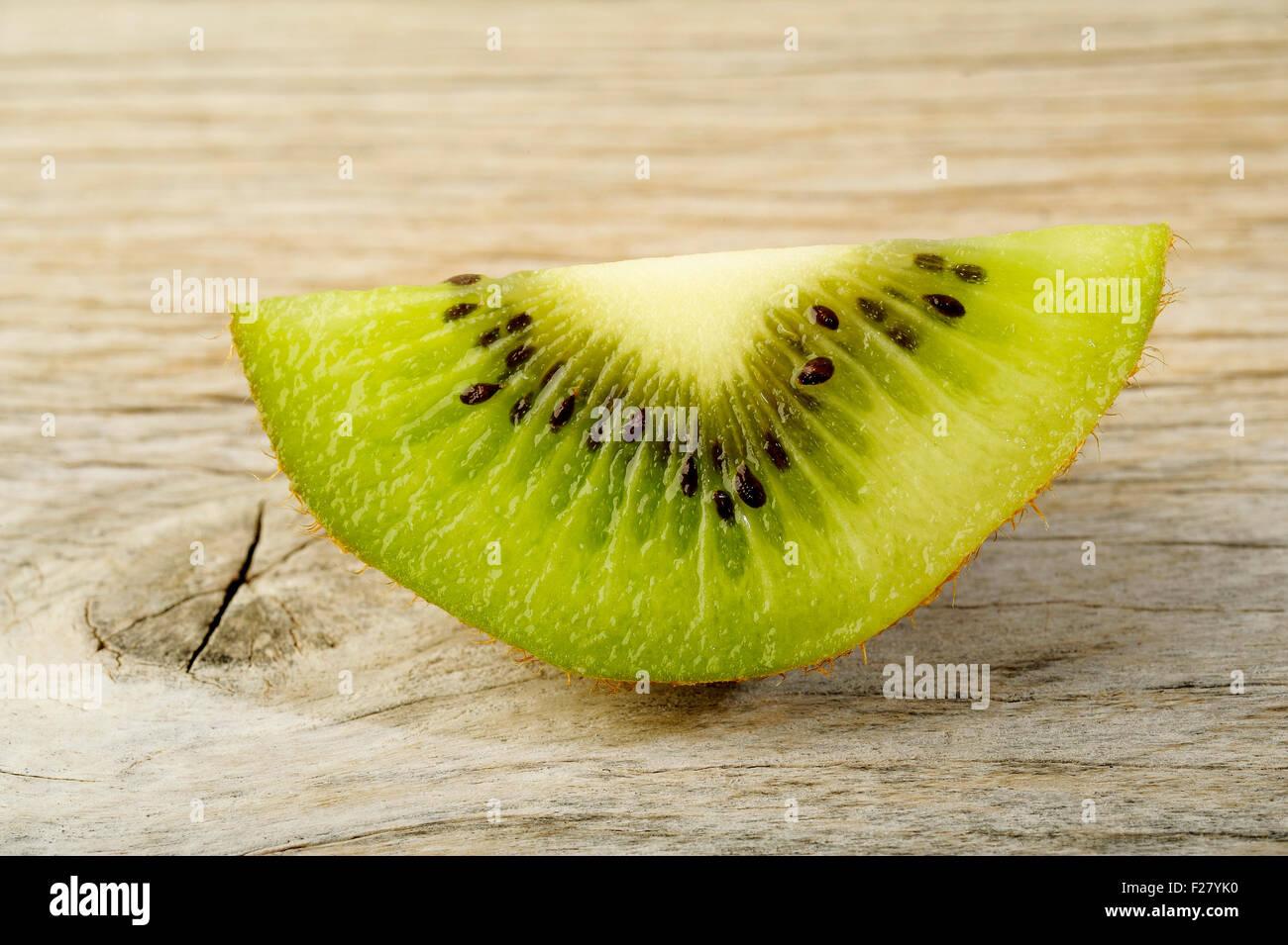 kiwi fruit on old wooden background - Stock Image