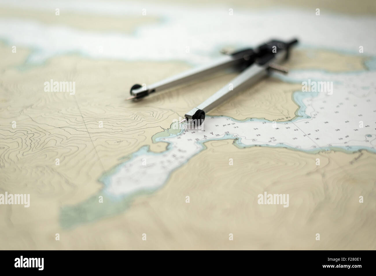 Divider caliper, also known as a compass, on a nautical chart of part of Southeast Alaska. - Stock Image