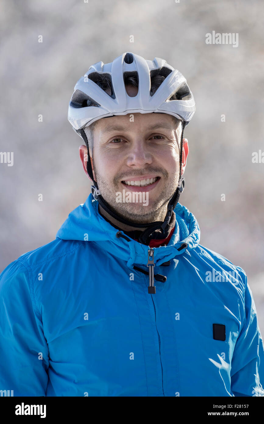 Portrait of mountain biker smiling, Bavaria, Germany - Stock Image