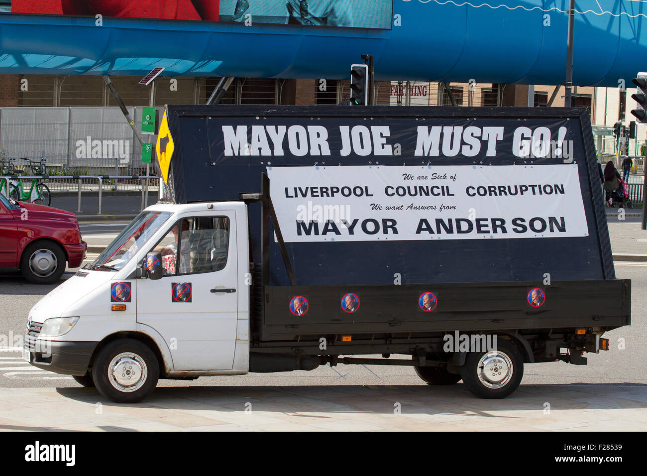 Parked campaign vehicle with poster calling for removal of local Mayor Anderson, Liverpool, Merseyside, UK - Stock Image