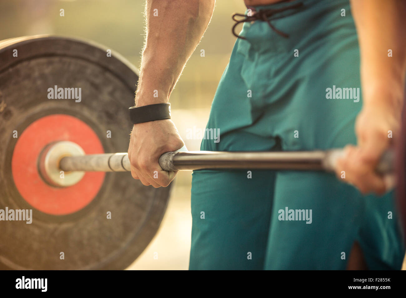 Closeup portrait of a man workout with barbell - Stock Image